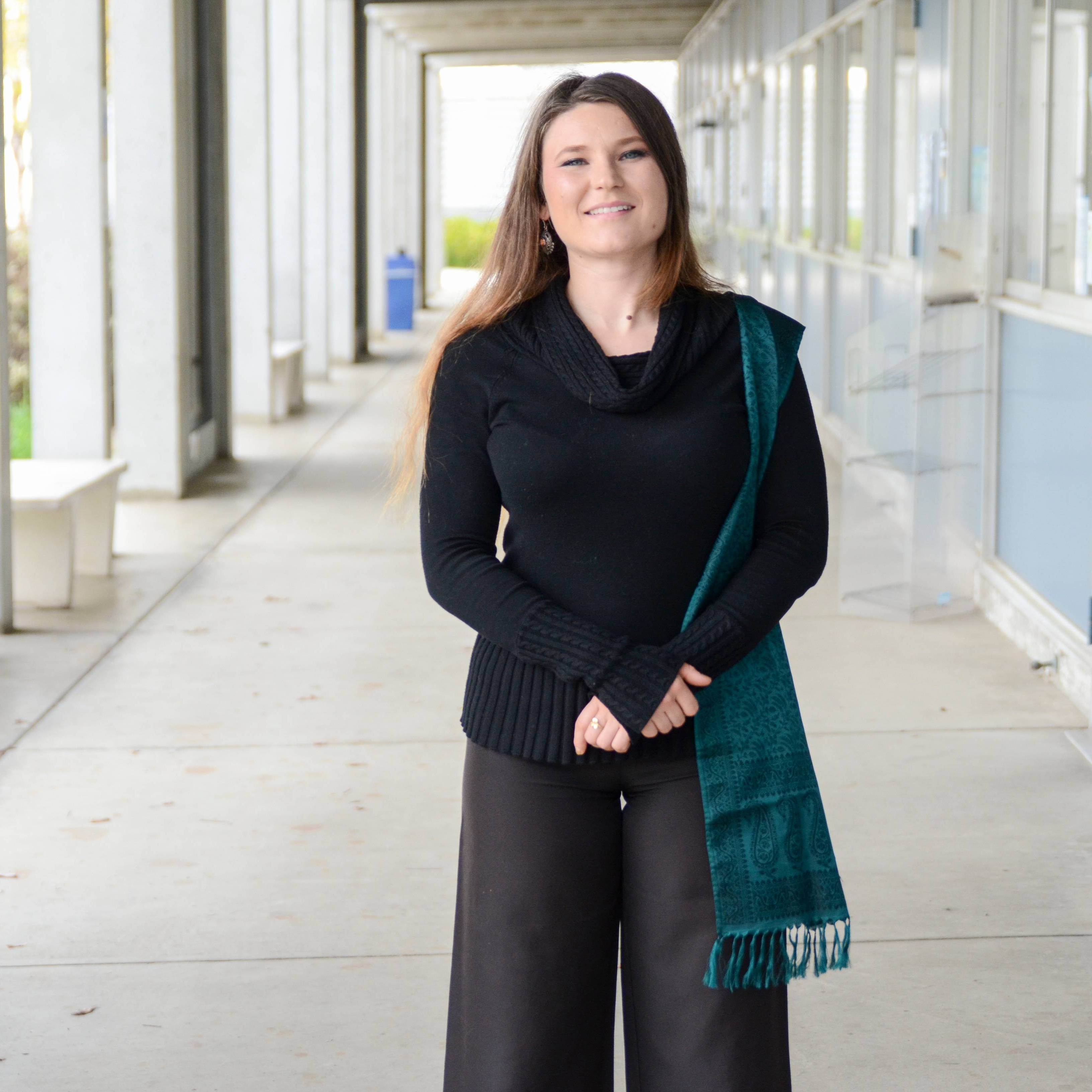 Fashion Technology major Kara Riekstins also used the brown suit as her inspiration, designing a brown and black dress with faux fur trim, also inspired by the brown outfit in the SDHC.