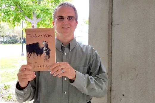 scott starbuck with his book hawk on wire
