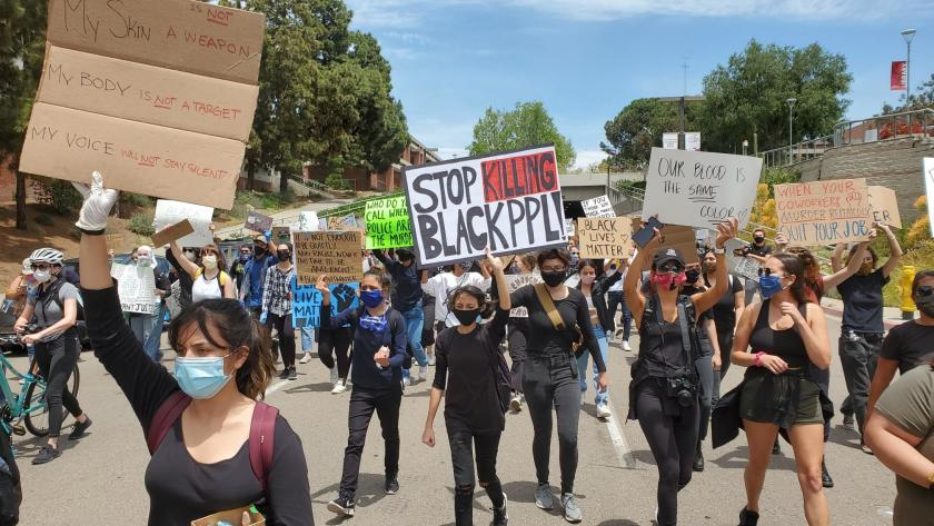 Young protesters, including many San Diego-area high school and college students, marched through Balboa Park