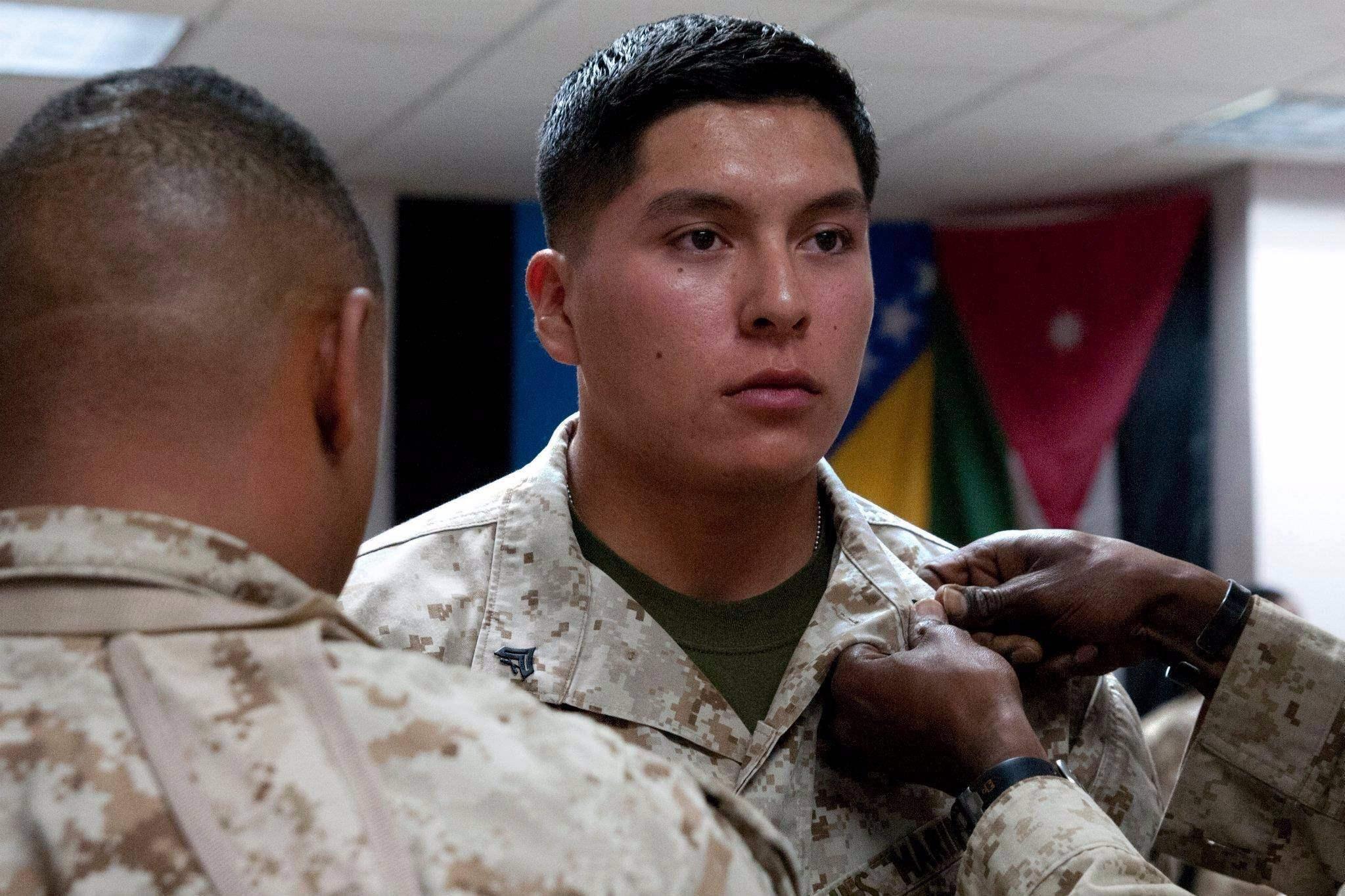 Freddy Cervante receives a pin during a promotion ceremony in 2012 at Camp Leatherback in Helmand Province, Afghanistan.