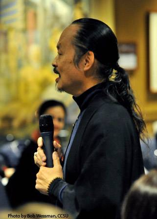 Speaker Lee Mun Wah with a microphone